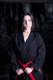 Training Marital Arts. Conceptual photo of young female assassin Stock Photography