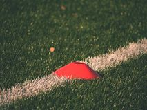 Training mark in soccer playfield. White line marks painted on artificial green turf background Stock Image