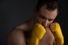 Training martial arts, looking away Royalty Free Stock Photos