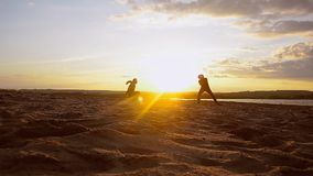 Training men in volleyball on beach in sun, beach volleyball on sand on summer evening. stock video