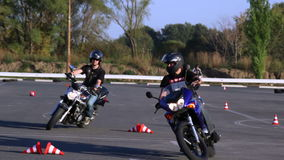 Training motorcycle driving skills Motoschool stock video