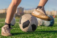 Training of the national football team. Legs of a boy in boots a royalty free stock images