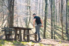 Training in nature by the bench Stock Photo