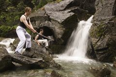 Training near waterfall Stock Image