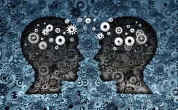 Training Neuroscience Development. Concept as a group of cog wheels and gears shaped as human heads with information transfer as a technology brain symbol or Stock Images