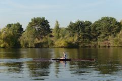 Training of oarsmen on the Moscow River in the Serebryany Bor. Moscow. MOSCOW, RUSSIA - SEPTEMBER 24, 2015: Training of oarsmen on the Moscow River in the Royalty Free Stock Photo