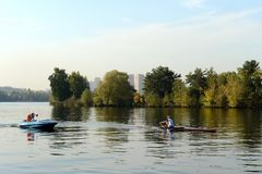 Training of oarsmen on the Moscow River in the Serebryany Bor. MOSCOW, RUSSIA - SEPTEMBER 24, 2015: Training of oarsmen on the Moscow River in the Serebryany Stock Photography