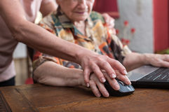 Training of an old person to new technologies Stock Images
