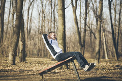 Training outdoors,sit-ups Royalty Free Stock Images