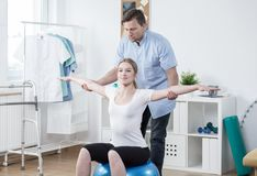 Training with physiotherapist Stock Photo