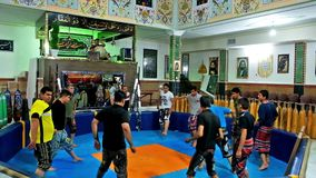 Training in pit of Zurkhaneh sport club. KERMAN, IRAN - OCTOBER 15, 2017: Traditional training in pit of Zurkhaneh sport club, the musician sings and plays the stock video footage
