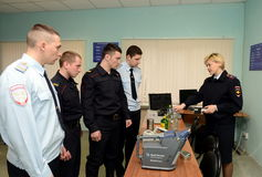 Training of police officers knowledge of modern portable screening equipment. PODOLSK, RUSSIA - MARCH 26, 2015:Training of police officers knowledge of modern Royalty Free Stock Photography