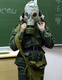 Training putting on the gas mask in the cadet corps of the police. Stock Photography