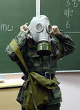 Training putting on the gas mask. Stock Image