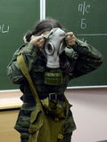 Training putting on the gas mask. Royalty Free Stock Photos
