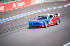 Training races of the high speed car on the autodrom. Stock Photos