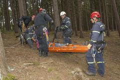 Training rescue injured people in difficult terrain Royalty Free Stock Photo