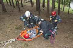 Training rescue injured people in difficult terrain. Pnovany, Czech Republic, June 4, 2014: Training rescue injured people in difficult terrain at the dam Royalty Free Stock Photo