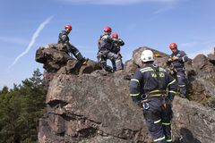 Training rescue team. Rescue in rocky terrain Royalty Free Stock Images