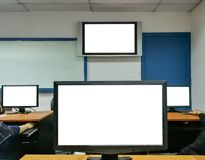 Training room inside computer school institute, white screen. royalty free stock photography