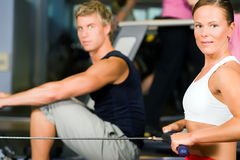 Training with rowing machine Royalty Free Stock Images