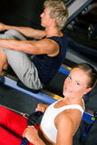 Training with rowing machine Stock Photo