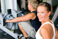 Training with rowing machine Stock Image