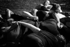 Training rugby team. Black and white photography stock photo