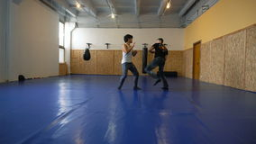 Training sparring two young guys in the hall of MMA. Practice melee combat in the martial arts hall stock video footage
