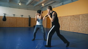 Training sparring two young guys in the hall of MMA. Practice melee combat in the martial arts hall stock footage