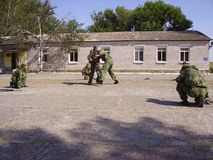 Training special forces of the Russian army, two in sparring, the rest are waiting in line. stock photography