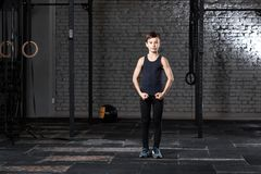 Training and sport. Kid in crossfit gym. Healthy lifestyle. stock image
