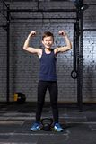 Training and sport. Kid in crossfit gym. Healthy lifestyle. royalty free stock photography