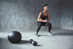 Training. Sports Woman In Fashion Sportswear Doing Squats stock image
