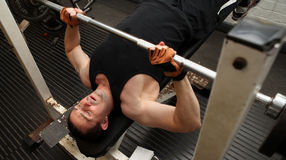 Training strength barbell gym Stock Photography