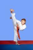 Training strike yoko-geri athlete in white karategi Stock Images