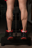 Training Strong Legs Calf Close-Up. Bodybuilder Doing Heavy Weight Exercise For Legs Calves Close Up Royalty Free Stock Images