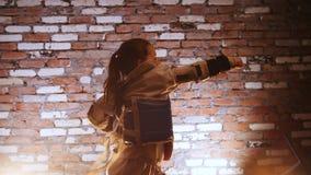 Training studio. Martial arts. A girl training her karate skills. Mid shot stock video footage