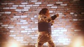 Training studio. Martial arts. A little girl training her karate skills. Mid shot stock footage