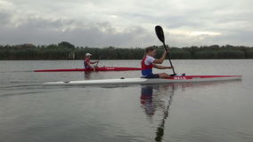 Training team in a kayak. Zabalj;Serbia; 08.03.2016.National team rowers in a kayak on the preparations for the Summer Olympic Games 2016. Video clip stock video