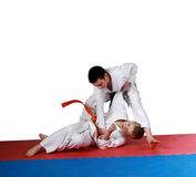 Training techniques nage-waza athletes in kimono Stock Photo