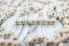 Training text on a wood blocks at wooden table Stock Photo