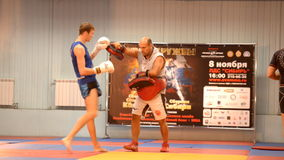 Training in Thai boxing. Novosibirsk, Russia - October 16, 2014: Asian champion in Thai boxing, coach Dmitry Tropin in action during the open training. The event stock video footage