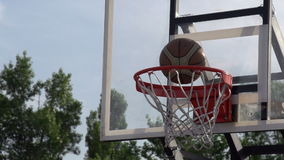 Training Throw of the Ball. The ball enters the basket basketball. Slow Motion at a rate of 240 fps stock footage