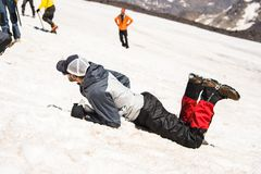 Learning to slip properly on a slope or glacier with an ice ax Stock Images