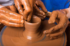 Training to potter's skill on a pottery wheel Stock Image