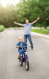 Training to ride a bicycle Royalty Free Stock Image
