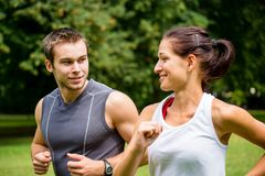 Training together - young couple jogging Royalty Free Stock Photos