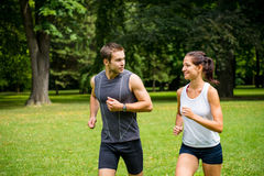 Training together - young couple jogging Royalty Free Stock Image