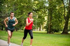 Training together - young couple jogging Royalty Free Stock Photo